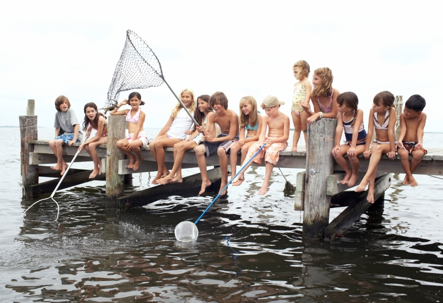 Group of children (3-12) fishing on jetty (Digital Composite)